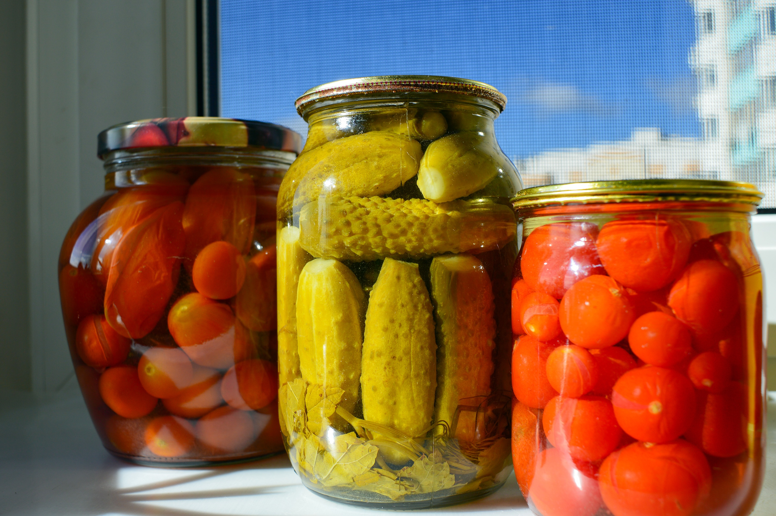 Canva - Pickled Cucumbers and Tomatoes in Glass Jars